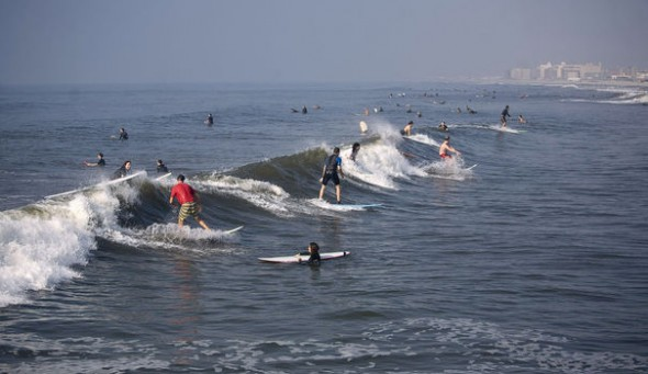 people surf at rockaway beach in new york